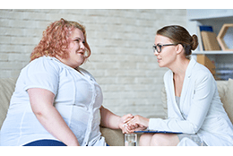 healthcare provider counselling a person with obesity