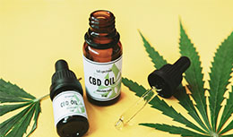 image of small bottle of cbd oil and droplet