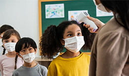 image of kids getting their temperature checked