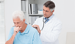 Doctor talking to a Middle-aged person coughing or appearing short of breath