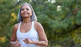 Senior female patient enjoying a run outside