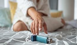 hand reaching for inhaler