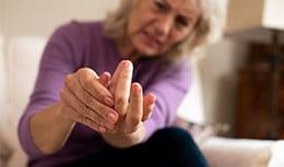 woman massaging own hands
