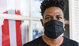 Young black male wearing a mask
