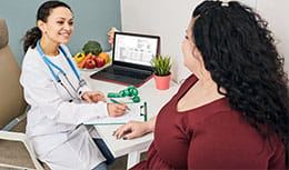 Physician talking with female patient