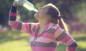 young arobecist drinking bottled water