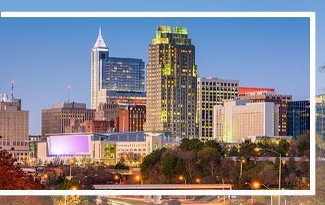 Ralrigh skyline with border, home of Pri-Med's CME conference in Raleigh, NC