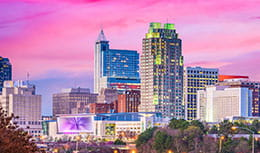 Raleigh sunset skyline, home of Pri-Med's CME conference in Raleigh, NC