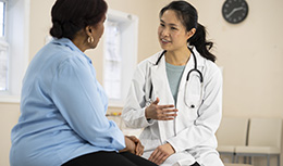 Doctor talks to African American patient